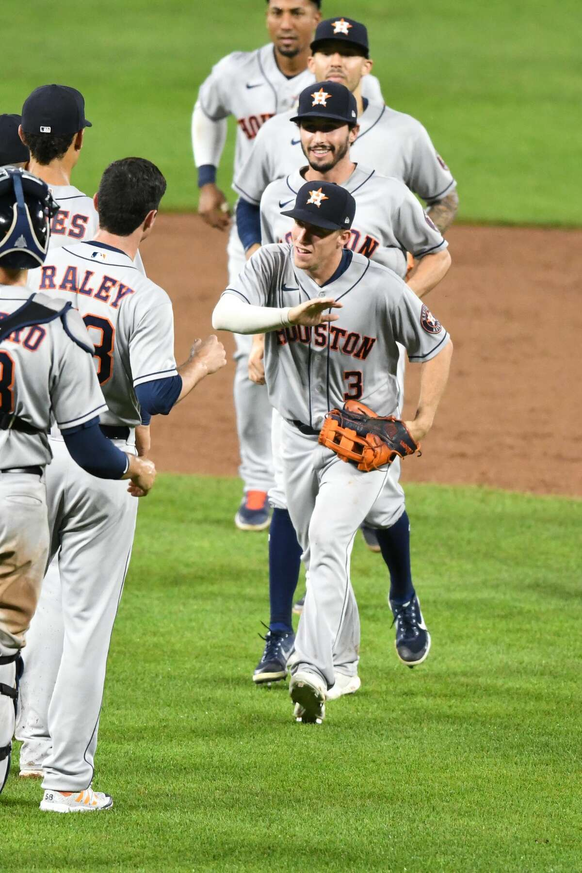 BALTIMORE, MD - JUNE 21: Myles Straw #3 of the Houston Astros celebrates a win with teammates after a baseball game against the Baltimore Orioles at Oriole Park at Camden Yards on June 21, 2021 in Baltimore, Maryland. (Photo by Mitchell Layton/Getty Images)