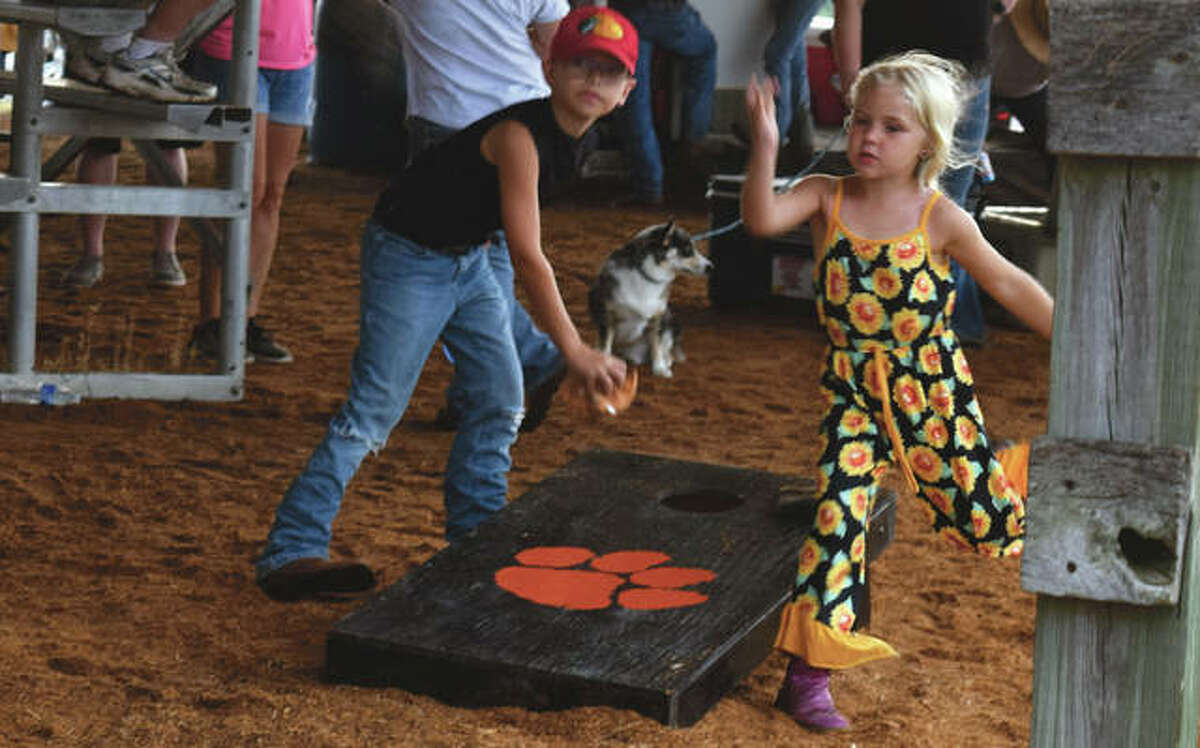 Brooke Thornton (right), 6, and Kellen Brannan, 8, play a game of bags at the Greene County Fair. The fair continues today with the Little Miss, Junior Miss and Miss Greene County Fair pageants at 6:30 p.m. in the grandstand.
