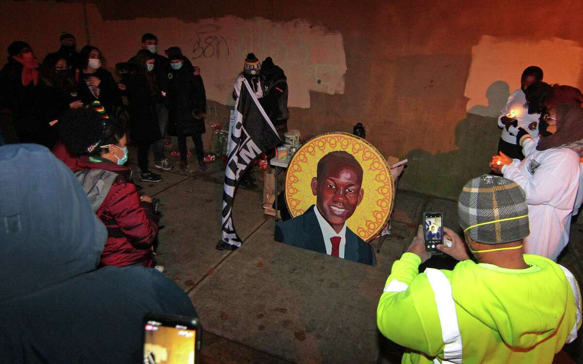 A vigil is held in memory of Mubarak Soulemane at the I-95 overpass along Campbell Avenue in West Haven on Jan. 15, a year after he was fatally shot by a state trooper.