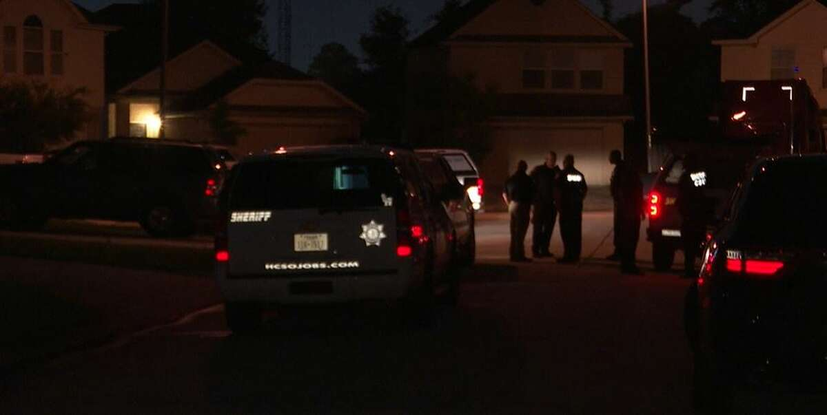 Investigators on the scene of a Monday night shooting in Harris County in which a child was struck by a bullet.
