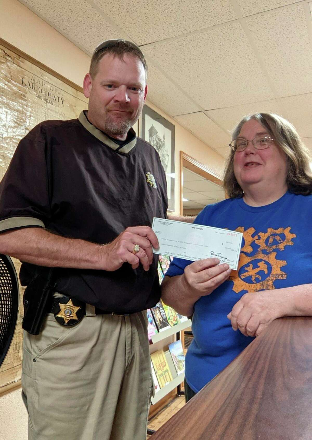 Lake County Sheriff Rich Martin presented Chase Public Library with a donation of $1000 this week as part of the Sheriff's Charitable Campaign. (Submitted photo)