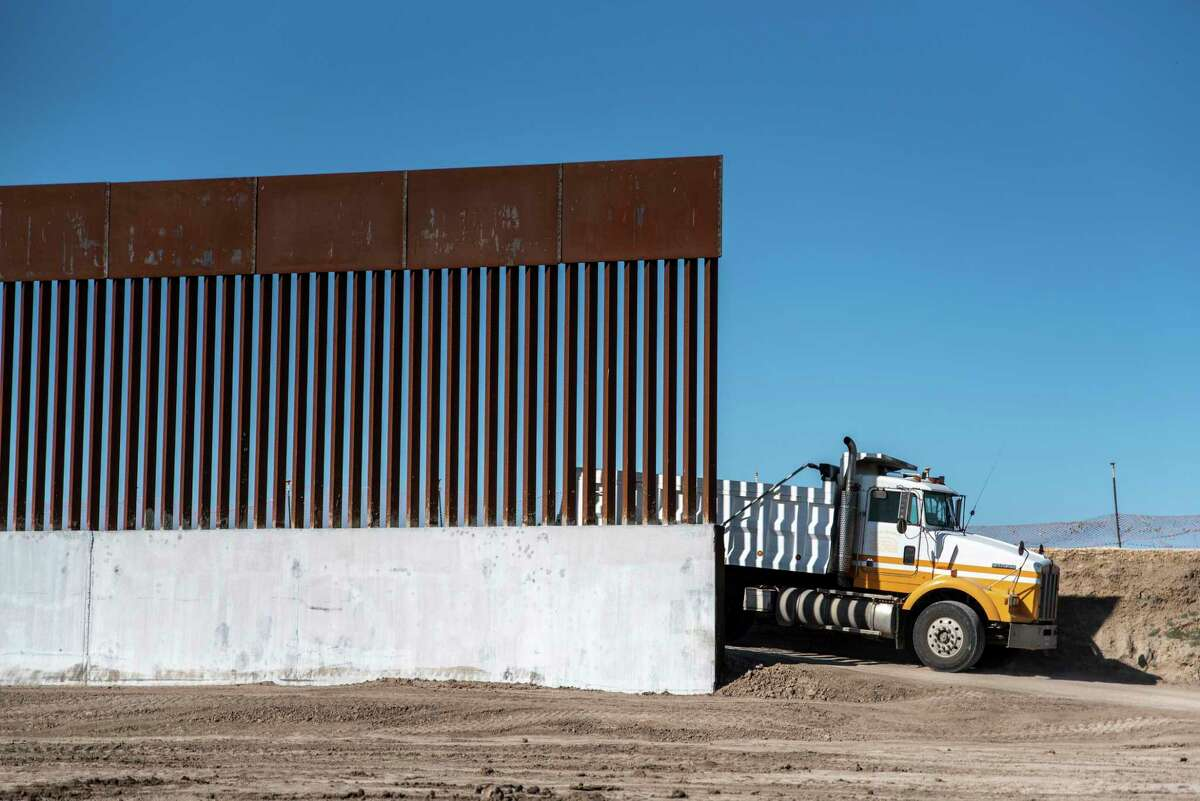 A dump truck moves along a selection of completed border wall near McAllen, Texas on Oct. 29, 2020. Laredo City Council announced Monday night that it plans to send a letter of opposition to Gov. Greg Abbott on his plans for a border wall paid by the state and through crowdfunding.