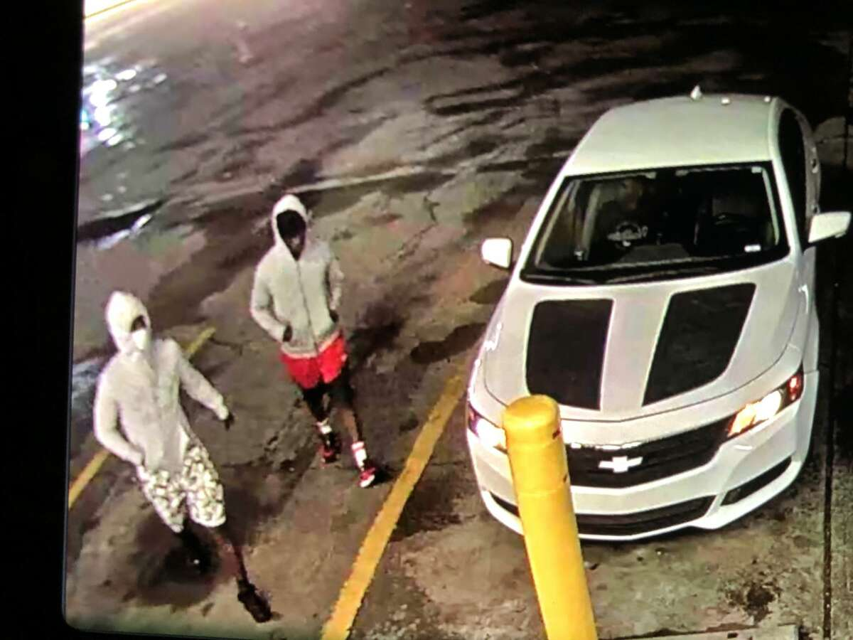 Houston police on Tuesday morning released an image from surveillance footage of two suspects and a white sedan that investigators believe were involved in a fatal shooting on Monday night.