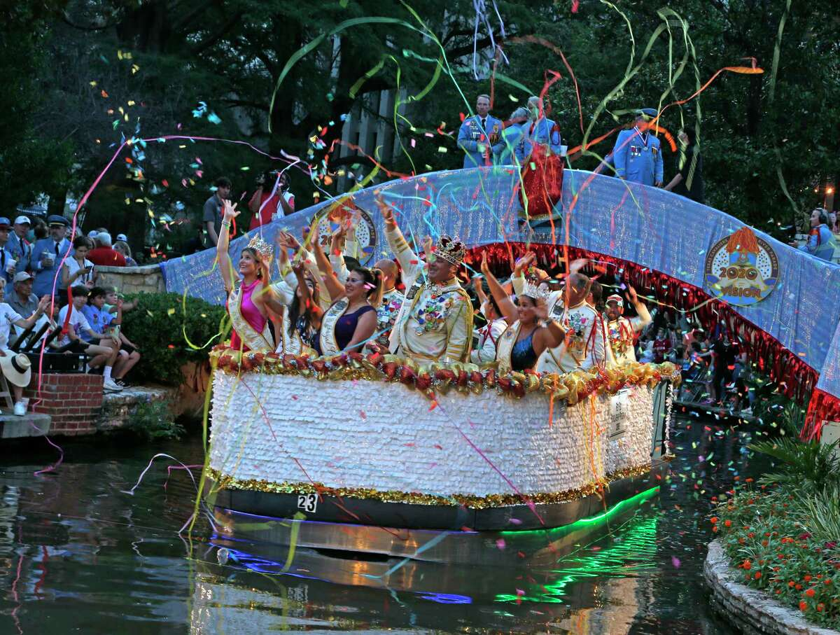 Rey Feo Scholarship program float is greeted with a barrage of confetti and streamers at the Texas Cavaliers River Parade on Monday, June 21, 2021.
