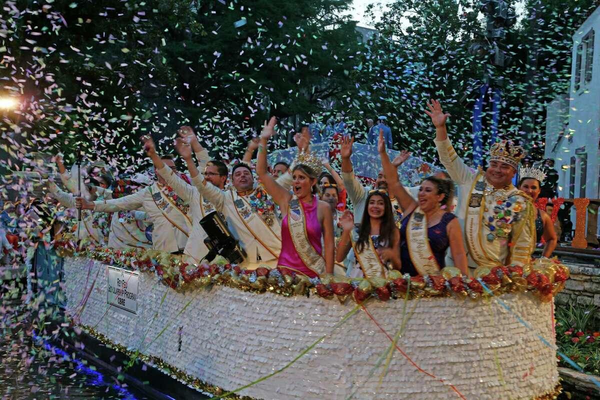 Rey Feo Scholarship Program greets spectators at the Texas Cavaliers River Parade on Monday, June 21, 2021.