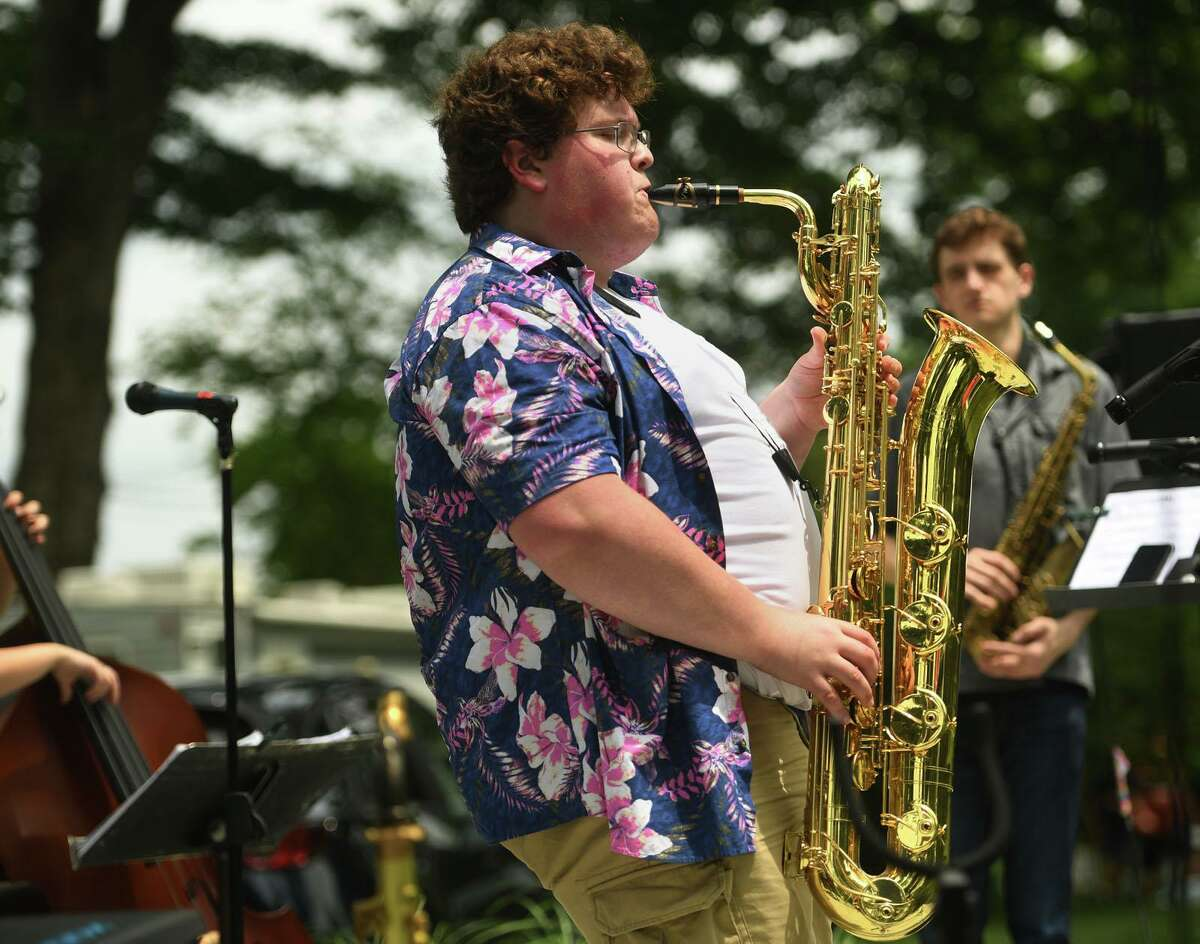Thomas Hasselberger, of Newtown, solos as fellow sax player Ryan Francis, of Ridgefield, looks on during a Make Music Day jazz performance by the Scott Robert Sextet at Ballard Park in Ridgefield.