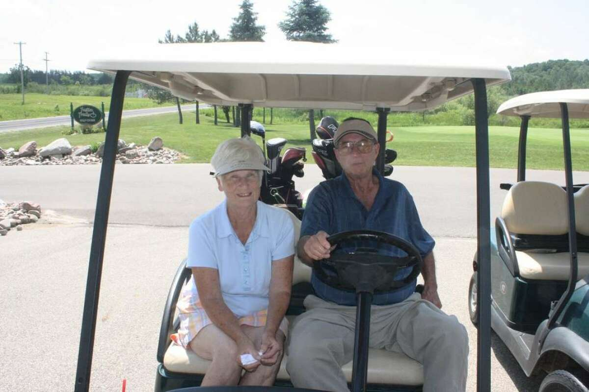 FILE - Marge and Jerry Selbee, of Evart, get ready for another day of action in the Tustin Trails Golf Course couples league.