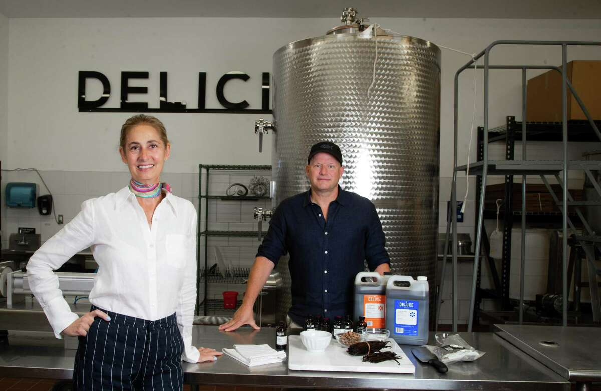 Deluxe Vanilla founders Claudia Farinola and her husband Brad Dorsey, Tuesday, May 11, 2021, in Houston. Deluxe Vanilla is a line of vanilla extracts, vanilla pastes and blends produced sustainably in Uganda.