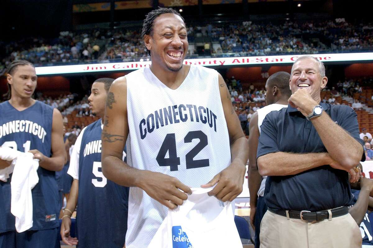 Donyell Marshall shares a laugh with UConn coach Jim Calhoun before the start of the Jim Calhoun Charity All-Star Game at the Mohegan Sun on Aug. 12, 2006.