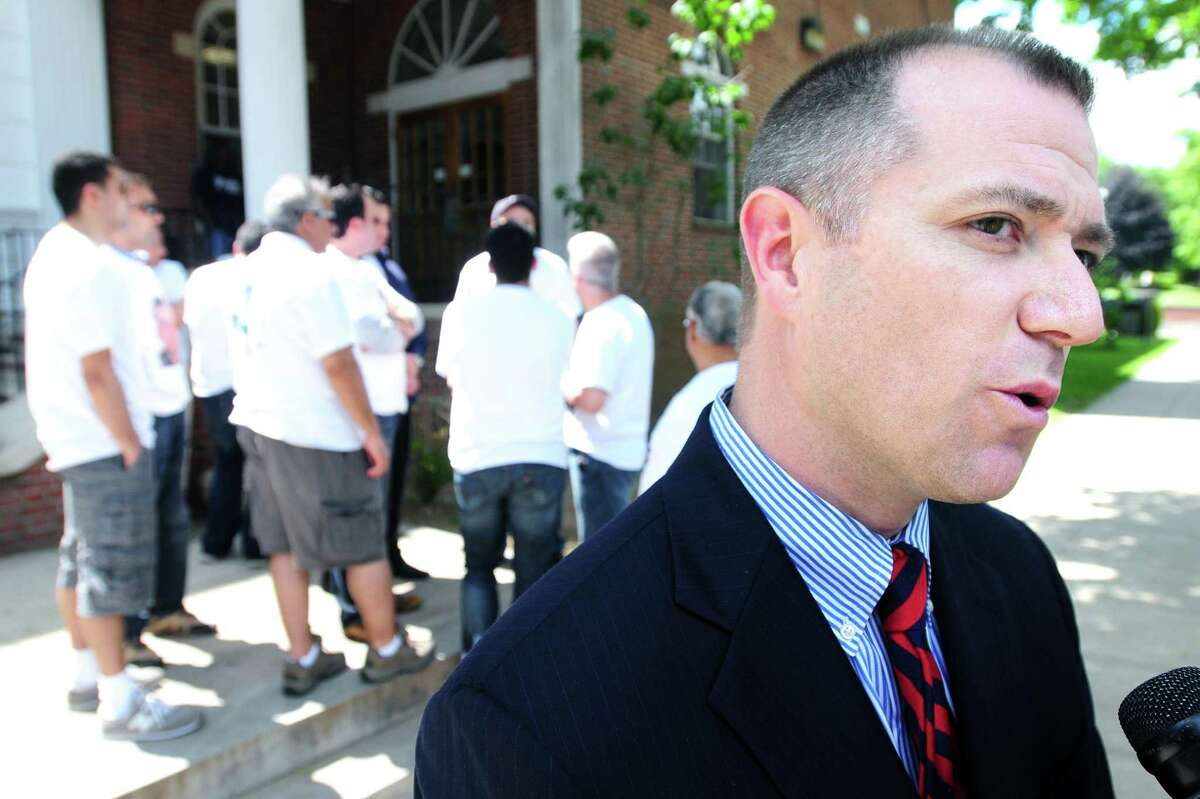 State's Attorney Kevin Lawlor (right) speaks to the press outside of Superior Court in Milford on 6/6/2011 after the arraignment of Bobby Kinnebrew for his part in the fatal shooting of West Haven Post Road Deli clerk Mohamed Bilal Altinawi on 5/9/2011. Photo by Arnold Gold/New Haven Register AG0413E