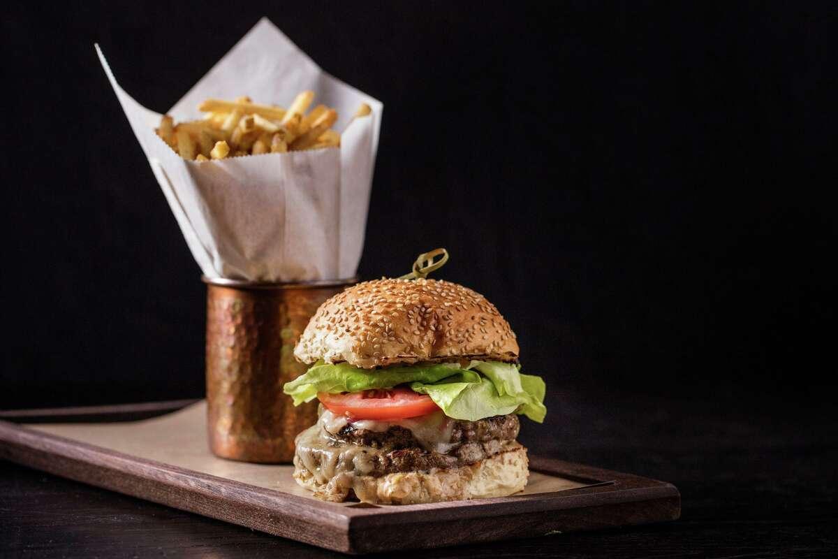 A Wheelhouse burger ($18) on seeded brioche features D'Artagnan grass-fed beef.