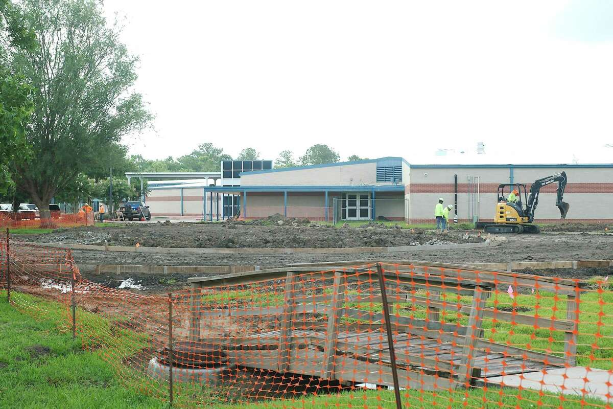 The new parking lot is expected to be finished by the time school starts.