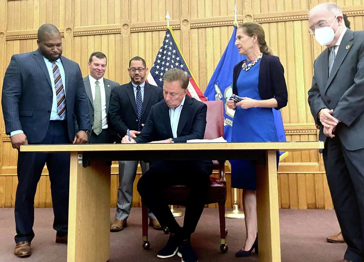 Gov. Ned Lamont signed a bill just after noon on Tuesday making recreational marijuana legal for adults in Connecticut starting July 1. From left are proponents Sen. Gary Winfield, D-New Haven; Rep. Steve Stafstrom, D-Bridgeport; House Majority Leader Jason Rojas, D-East Hartford; Lamont; Lt. Gov. Susan Bysiewicz; and Senate President Pro-Tem Martin Looney, D-New Haven.