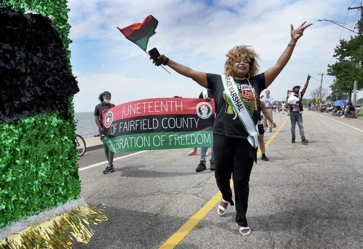 """Alrene """"Renie Love"""" Blake marches in the 29th Juneteenth Parade circling through Seaside Park in Bridgeport, Saturday, June 19, 2021."""