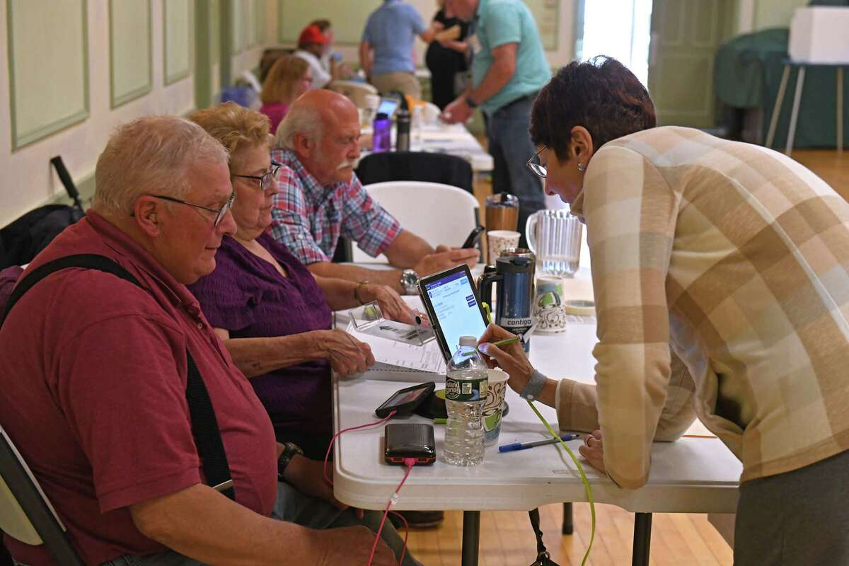 Leslie Boyer of Albany, right, signs in to vote during a primary at The Ancient Order of Hibernians on Tuesday, June 22, 2021 in Albany, N.Y. (Lori Van Buren/Times Union)