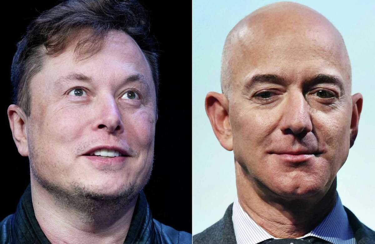 This combination of file photos created on July 15, 2020 shows SpaceX founder Elon Musk in Washington, DC, on March 09, 2020; and Blue Origin founder Jeff Bezos in Washington, DC, on October 22, 2019.