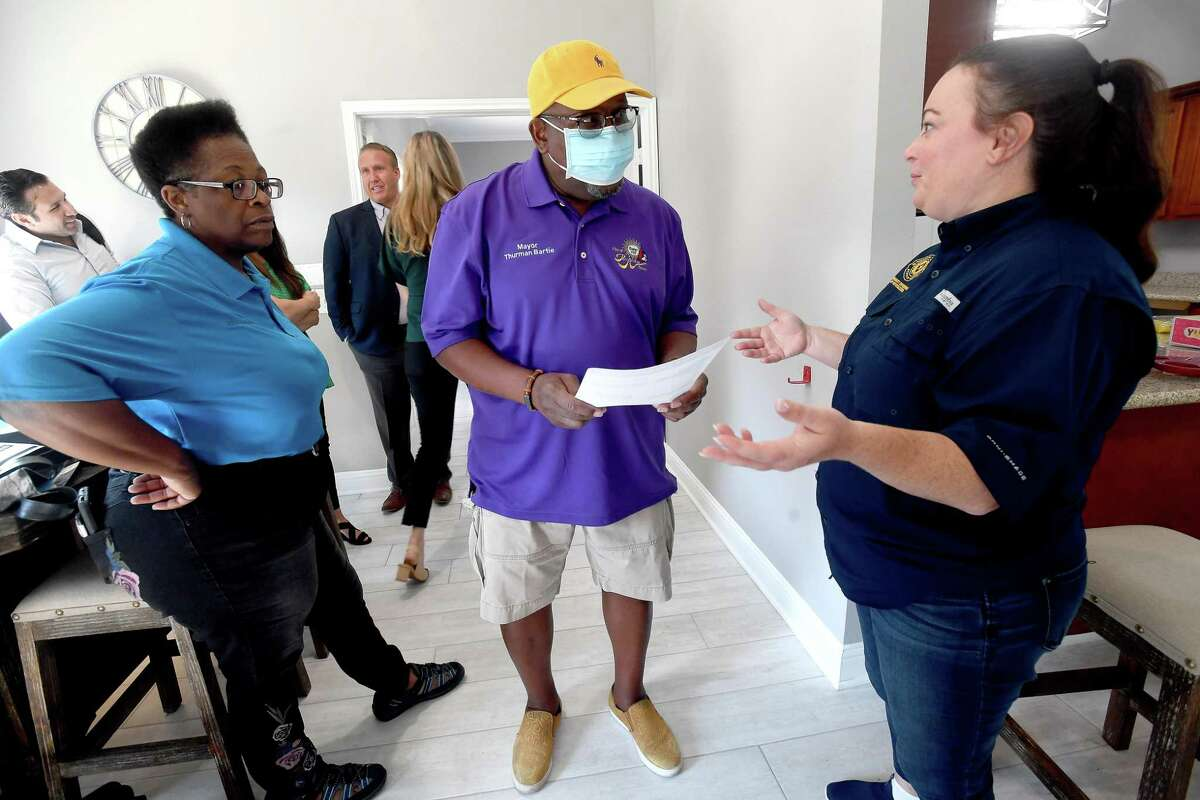 Mayor Thurman Bartie talks with GLO's Rhonda Masters (left) and Brittany Eck as he arrives at Pebble Creek Apartments in Port Arthur for a ribbon cutting and celebration of the final damage repairs that were made after Harvey using money from the GLO's disaster recovery assistance program. $16 million in grants were made available for multi-family dwelling repairs or new construction. Thirteen such units in Jefferson County - at least 5 of which were located in Port Arthur - benefitted from the program. Photo made Wednesday, June 16, 2021 Kim Brent/The Enterprise