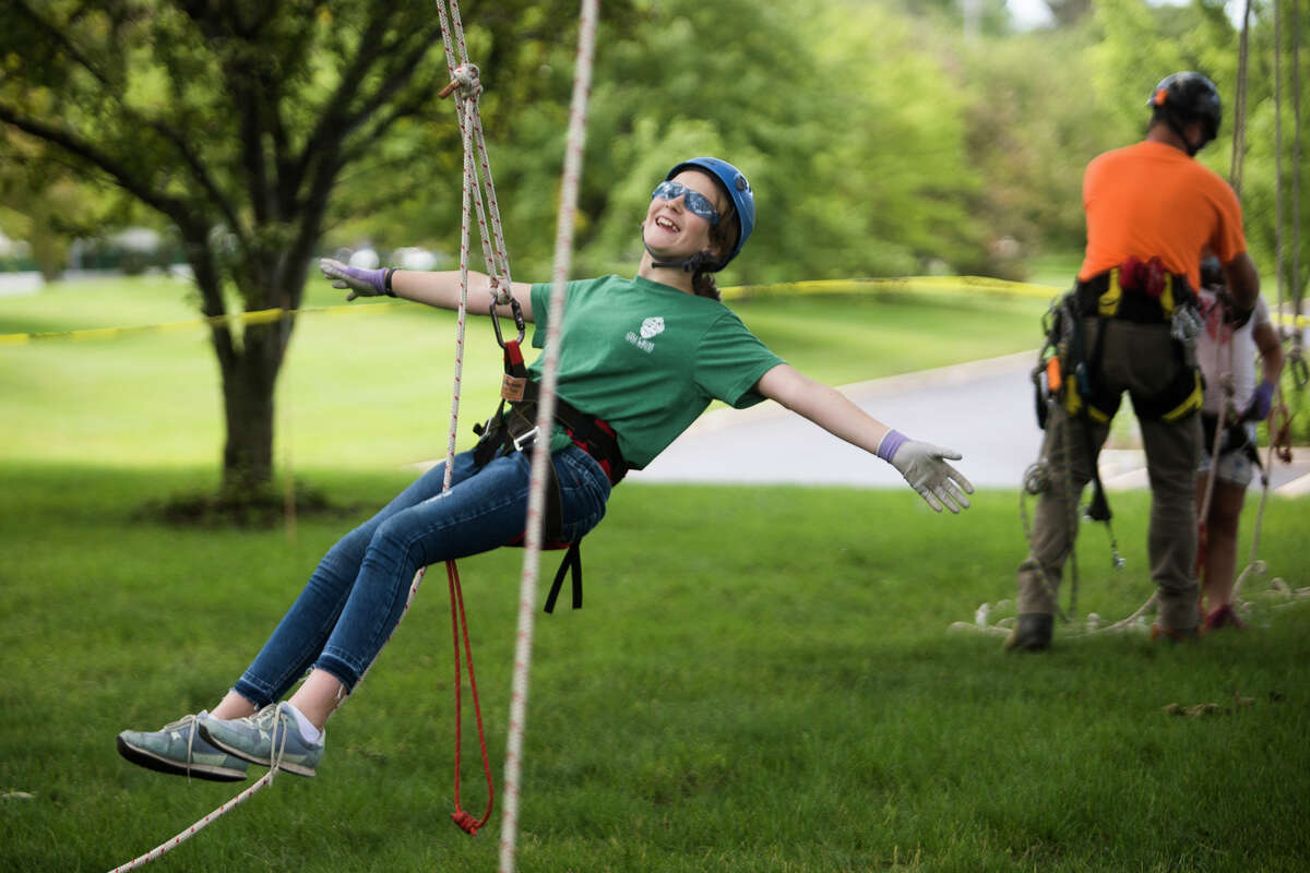 Lizzie Vanchura, 12, descends from a climb while participating in a tree climbing event hosted by arborists at Dow Gardens Tuesday, June 22, 2021 in Midland. (Katy Kildee/kkildee@mdn.net)