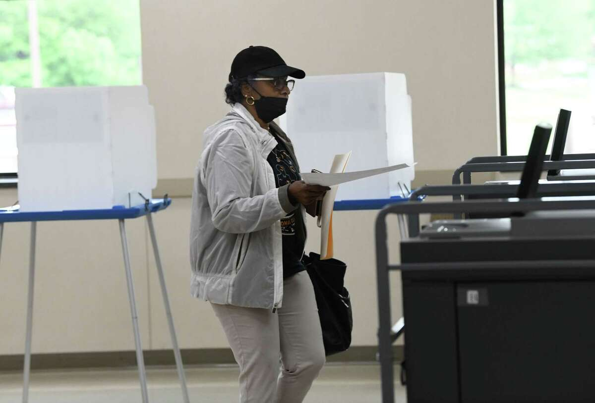 Nettie Crossman of Guilderland walks over and feeds her ballot into the voting machine at Westmere Fire Department which was a primary polling place for the Democratic Party on Tuesday, June 22, 2021 in Guilderland, N.Y. (Lori Van Buren/Times Union)