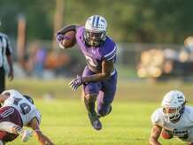 Eagles DeAnthony Gatson (9) leaves defenders in the dust as he runs for a touchdown in the first half. The Newton Eagles hosted the New Waverly Bulldogs for a rare Monday Night Football game. Photo made on October 12, 2020. Fran Ruchalski/The Enterprise