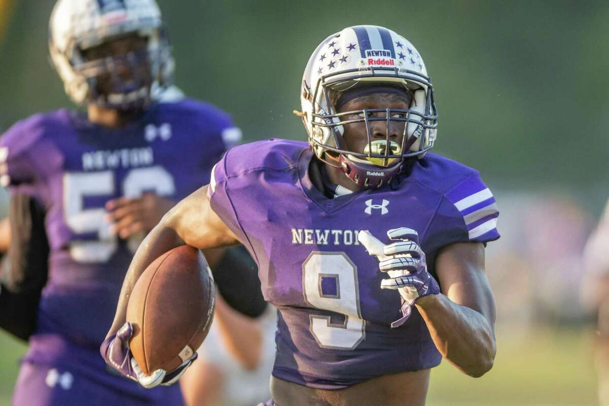 Eagles DeAnthony Gatson (9) runs for another touchdown in the first half. The Newton Eagles hosted the New Waverly Bulldogs for a rare Monday Night Football game. Photo made on October 12, 2020. Fran Ruchalski/The Enterprise