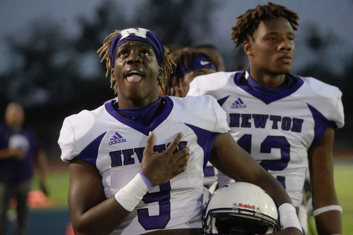 Newton's Deanthony Gatson and teammates observe the anthem before facing West Orange - Stark during their match-up Friday night in West Orange. Photo taken Friday, September 18, 2020 Kim Brent/The Enterprise