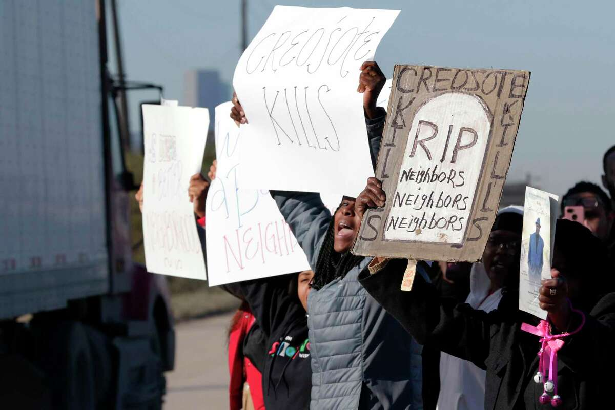 Protestors wave signs at passing trucks as they demonstrate roadside against Union Pacific at the rail yard affected by the creosote contamination in the 7500 block of Liberty Road Friday, Feb. 14, 2020 about five miles east of downtown in Houston, Texas.