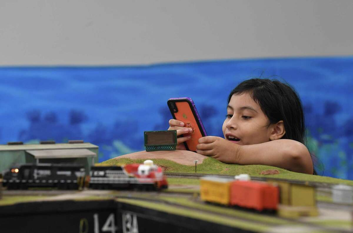 Guadalupe Sanchez enjoys the East Texas and Gulf Rail Modelers Association's model train show on display through Sunday at the Port Arthur Library. Photo made Friday, June 18, 2021 Kim Brent/The Enterprise