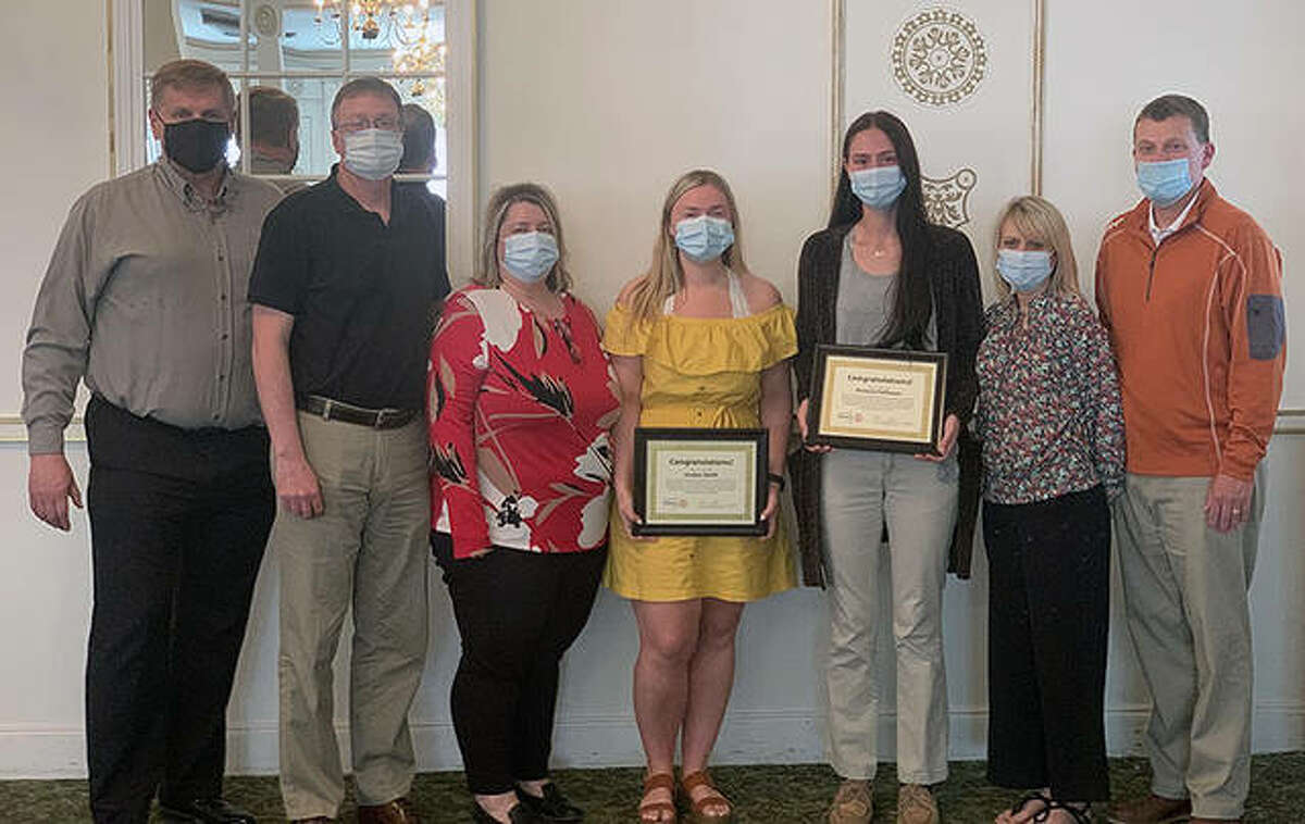 Rotarian Allen Stare (from left), Saan and Lori Smith, scholarship winner Jordan Smith, scholarship winner Victoria Fellhauer and Kim and Mike Fellhauer gather for a photo after the presentation of Rotary scholarships.