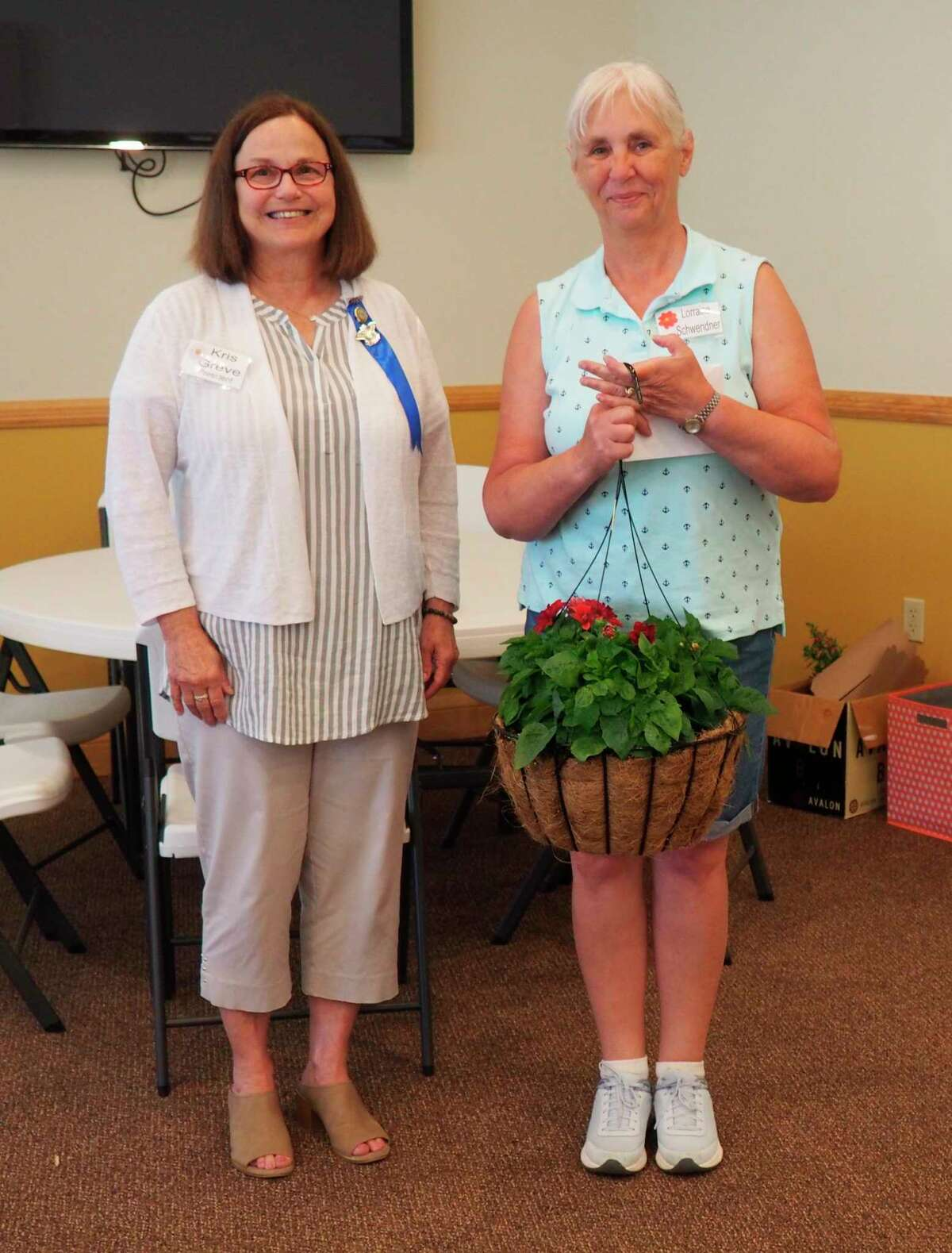 Spirit of the Woods Garden Club recognizedLorraine Schwendner for her service to the club. Pictured arepresident Kris Greve and former president Lorraine Schwendner. (Courtesy photo)