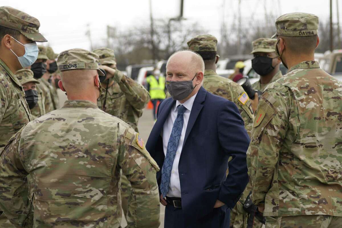 John Whitley, Acting Secretary of the Army, talks with soldiers as he toured the Dallas County's Community Vaccination Center at Fair Park on March 12. He viewed the site and discussed partnerships with the local community, FEMA, and the Department of Defense.