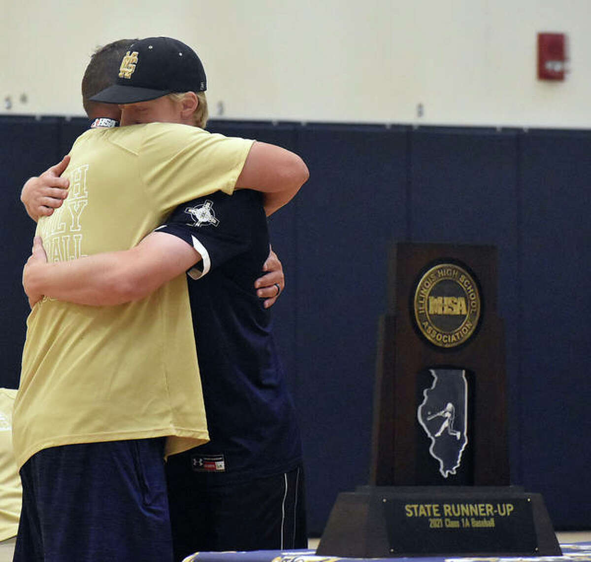 FMCHS senior Matthew Gierer, right, hugs coach Chris Erwin during a celebration on Friday at the school.