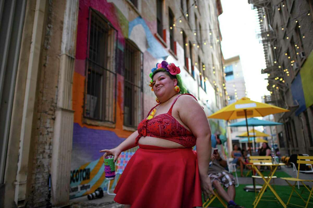 Abi Robles Membrez dances at Peacock Alley, a downtown San Antonio hotspot between 110 and 118 Broadway that hosts various artists, musicians and vendors.