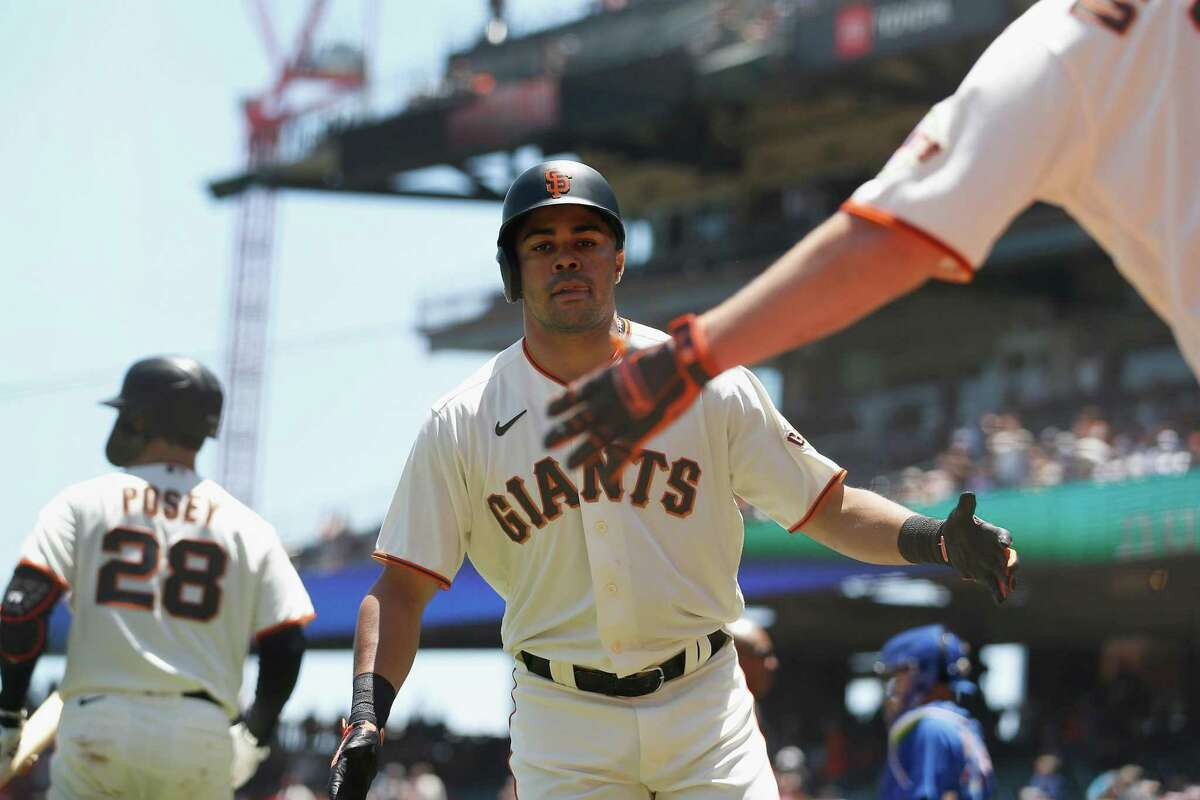 SAN FRANCISCO, CALIFORNIA - JUNE 06: LaMonte Wade Jr. #31 of the San Francisco Giants celebrates with Alex Dickerson #12 after hitting a solo home run in the bottom of the first inning against the Chicago Cubs at Oracle Park on June 06, 2021 in San Francisco, California. (Photo by Lachlan Cunningham/Getty Images)