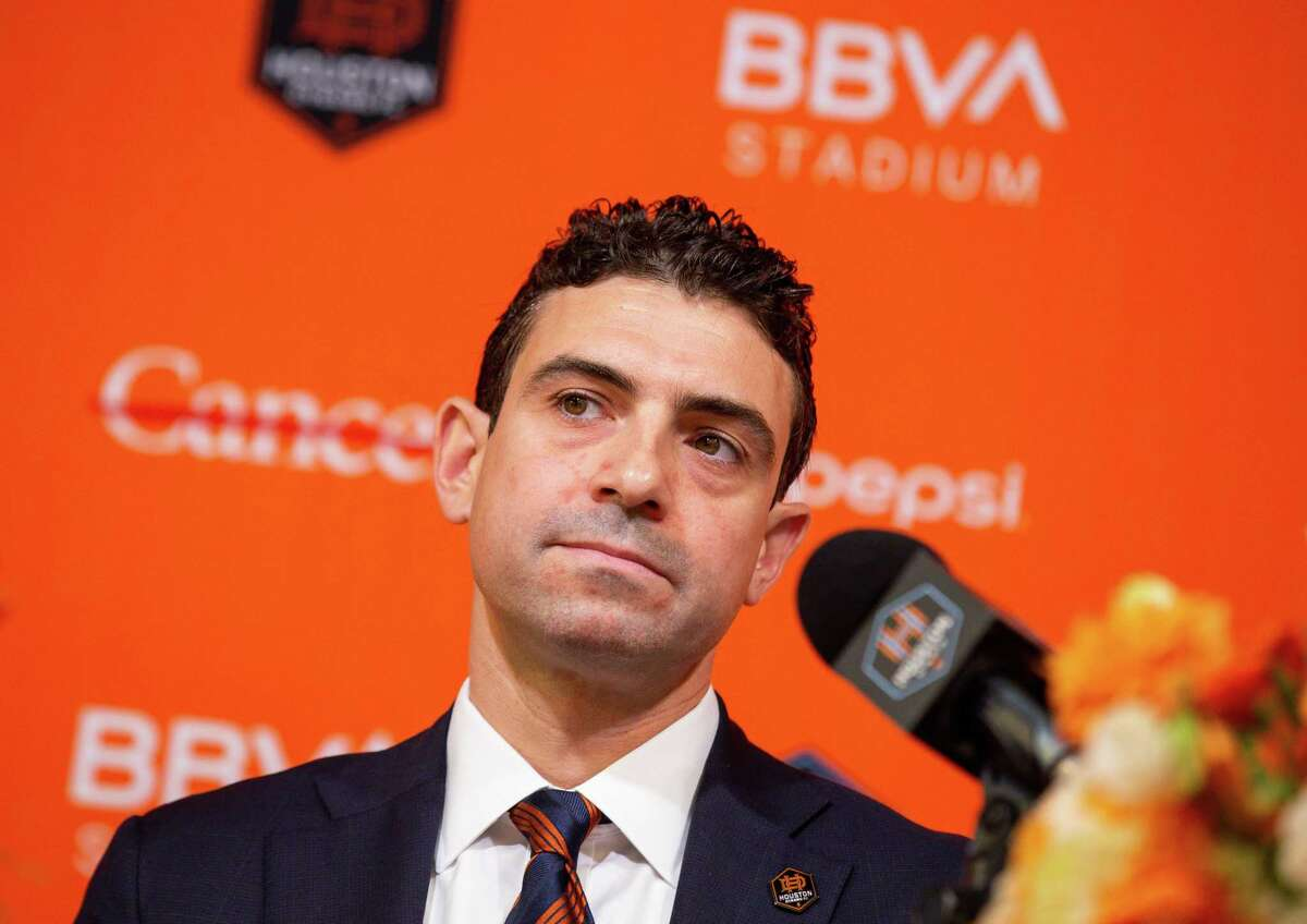 Ted Segal, left, answers questions from reporters during a presser's conference in which he was announced as the new majority owner of the Houston Dynamo FC and Dash Houston, at BBVA Stadium on Tuesday, June 22, 2021, in Houston.