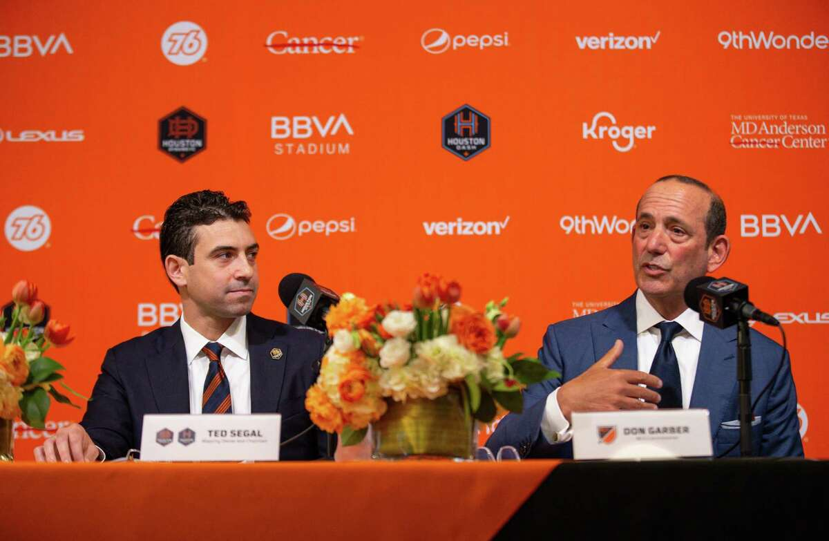 MLS commissioner Don Garber, right, answers question from a reporter during the press conference in which Ted Segal, left, was announced as the majority owner of the Houston Dynamo FC and Dash Houston, at BBVA Stadium on Tuesday, June 22, 2021, in Houston.