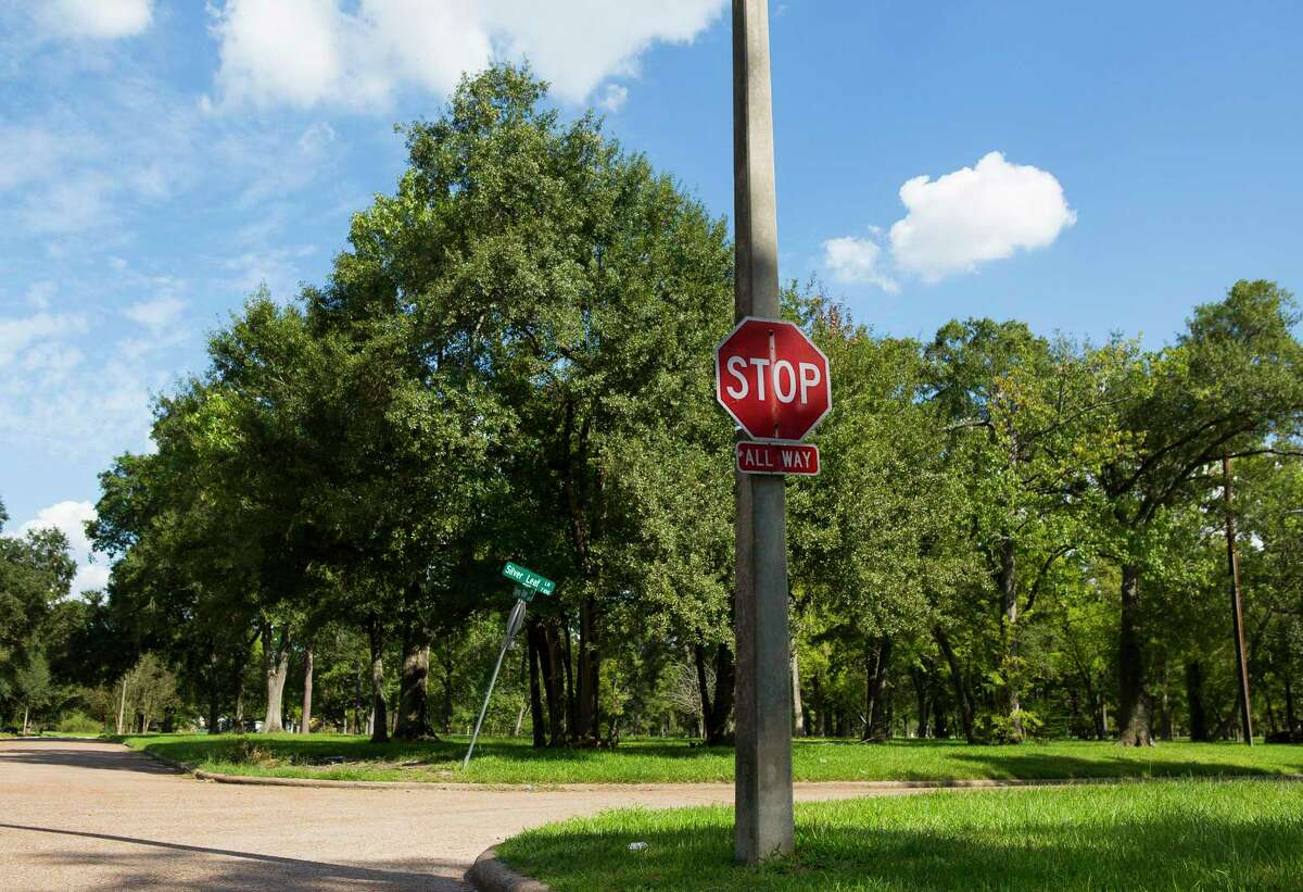 Empty streets greet visitors to the Arbor Oaks neighborhood, Monday, Sept. 17, 2018 in Houston where homeowners were offered buyouts after floods.