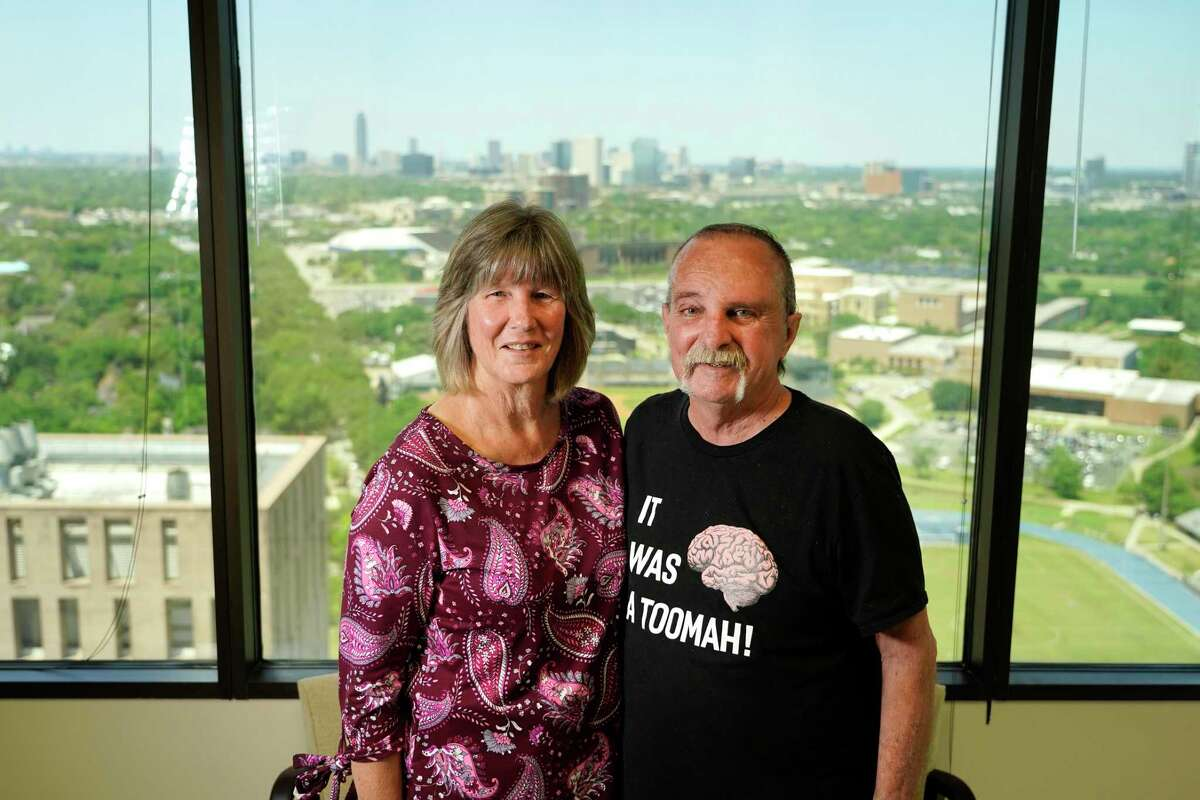 Gail DeHart, left, and her husband, Chris DeHart, who had three brain surgeries at Houston Methodist over the past six months, are shown Tuesday, April 20, 2021 in Houston. One surgery was an 18-hour procedure performed by Dr. David S. Baskin, director of the Kenneth R. Peak Brain & Pituitary Treatment Center, Dr. Michael J. Klebuc, plastic and reconstructive surgery, associate clinical professor, and Dr. Mas Takashima, chair, department of otolaryngology head and neck surgery. The trio collaborated to remove the rest of a massive atypical meningioma - a brain tumor that took over the DeHart's entire sinus cavity and had begun eroding the base of his skull.