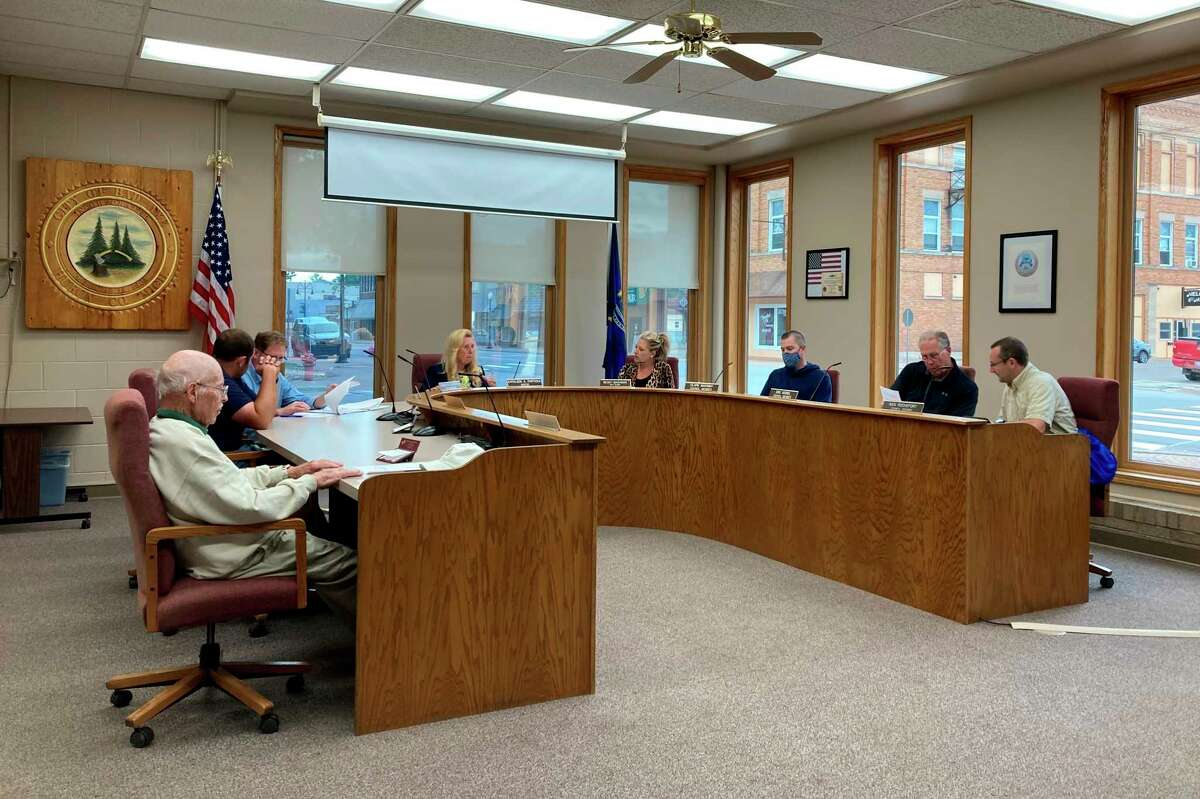 Bad Axe City Council members discuss the agenda at 7:30 p.m. before the June 20 meeting starts in City Hall.