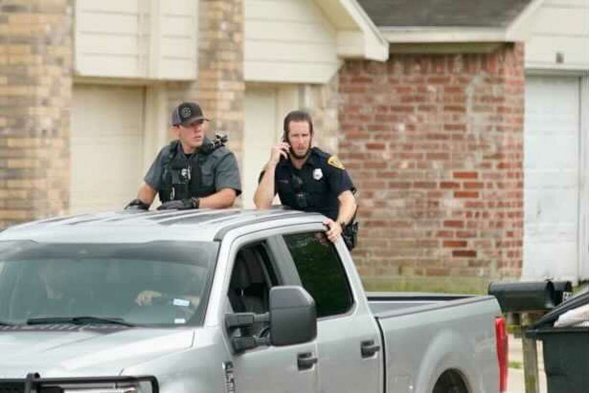 Police search a neighborhood near N. Houston Rosslyn Road on Tuesday afternoon.