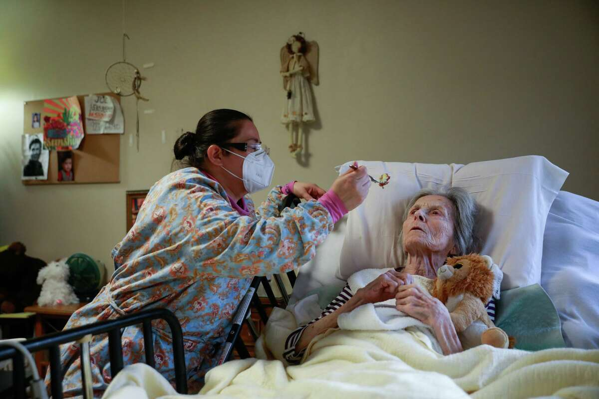 A caregiver feeds resident Pat Michelin at the Gordon Manor assisted-care facility in Redwood City. Deaths among Medicare patients in nursing homes shot up 32% last year, with two devastating spikes eight months apart, a government watchdog agency says.