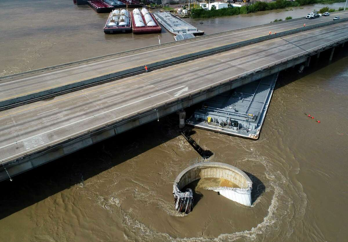 Interstate 10 at the San Jacinto River was shut down in both directions after multiple barges collided with the bridge on Sept. 20, 2019, in Houston, in the aftermath of Tropical Storm Imelda.