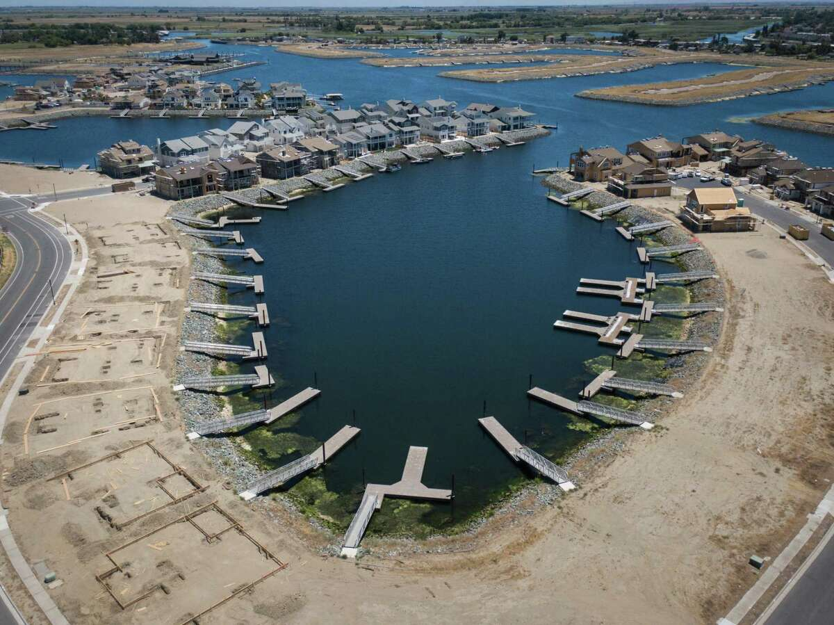 Homes and lots on the built up peninsulas at Delta Coves.