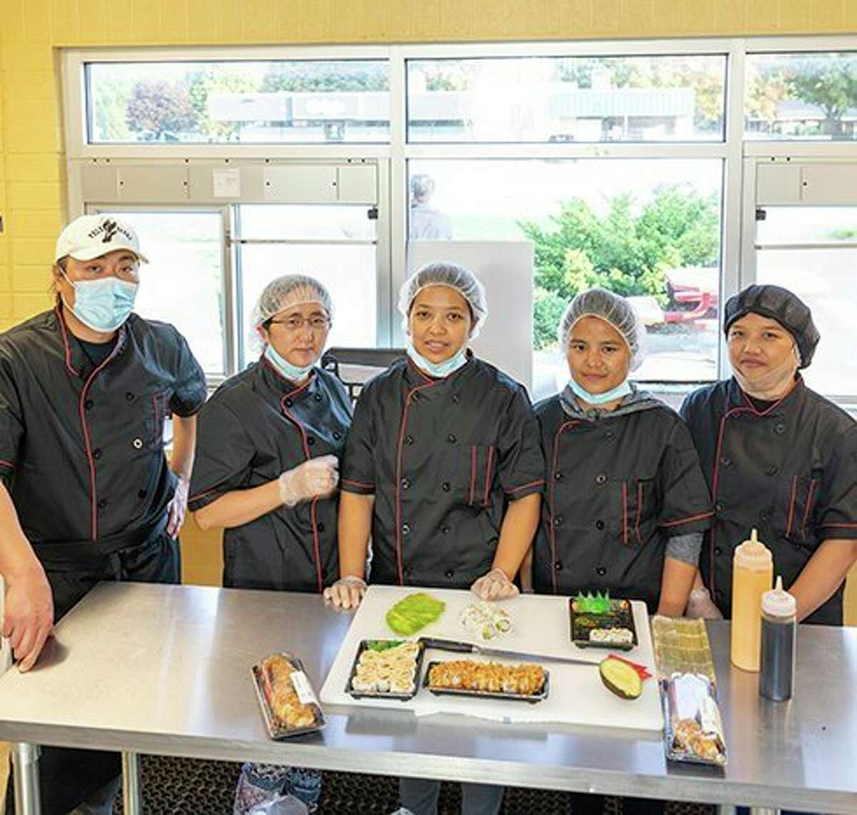 The Ferris State University Dining Services operation contracts with Grand Rapids-based Anu Sushi, a corporation whose production staff includes refugees from Myanmar, an Asian nation facing a violent political struggle. Anu Sushi provides a meal to orphans in Myanmar for each unit they sell. (Courtesy/John Smith)