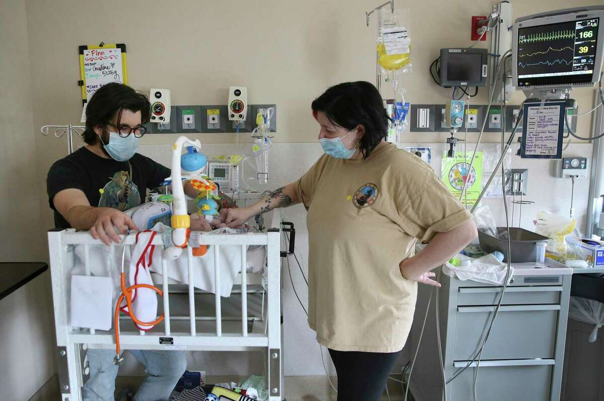 Parents Christopher Dailey and Halley Edmiston spend time with their 3-month-old son, Finn Dailey, in a San Antonio NICU. Aetna's commercial insurance customers in Texas may have trouble finding in-network pediatric care after July 1.
