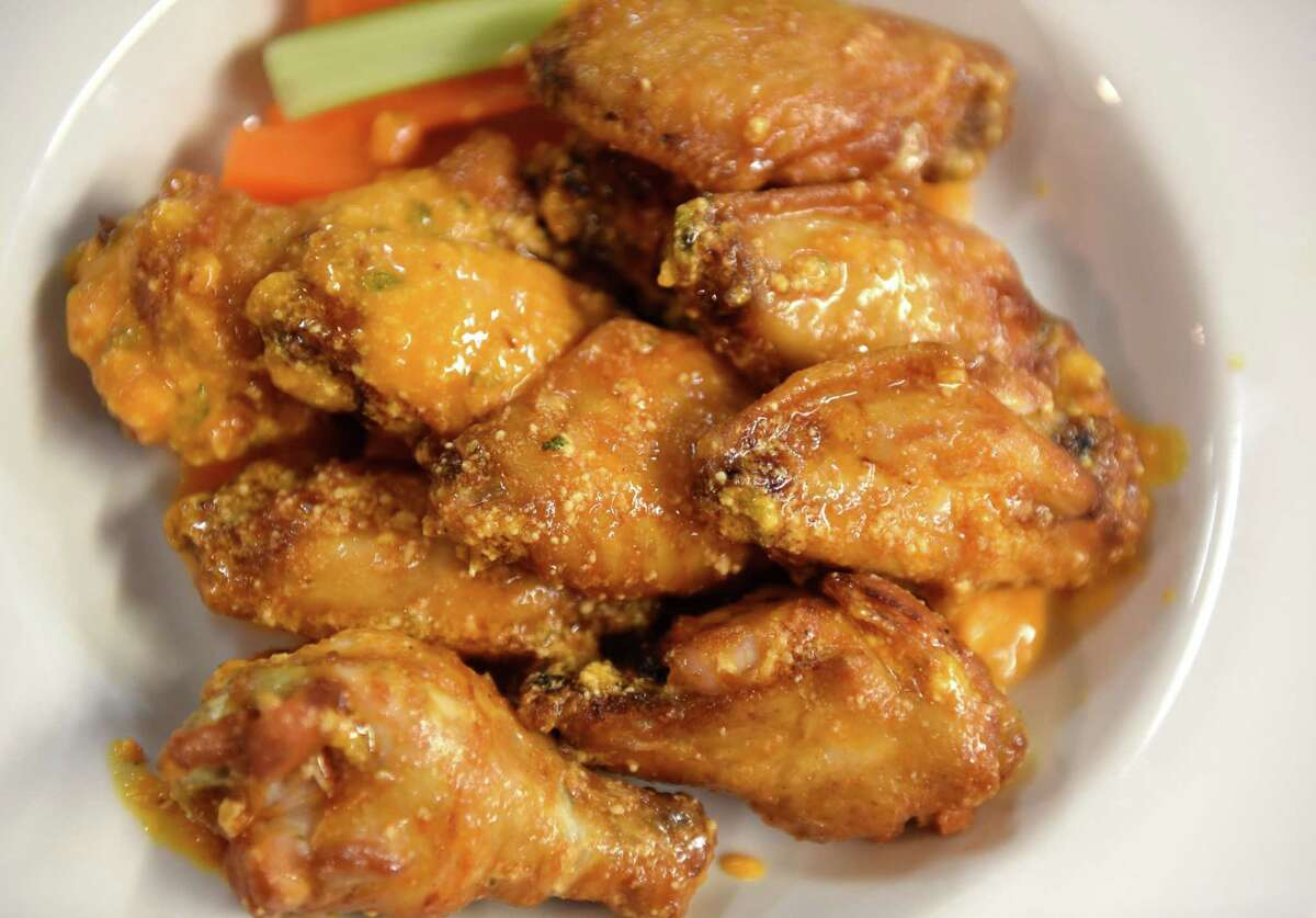 Chicken wings are cooked in a fryer at The Towne Tavern on Tuesday, June 22, 2021, in Averill Park, N.Y. Prices are rising for the popular finger food. (Will Waldron/Times Union)