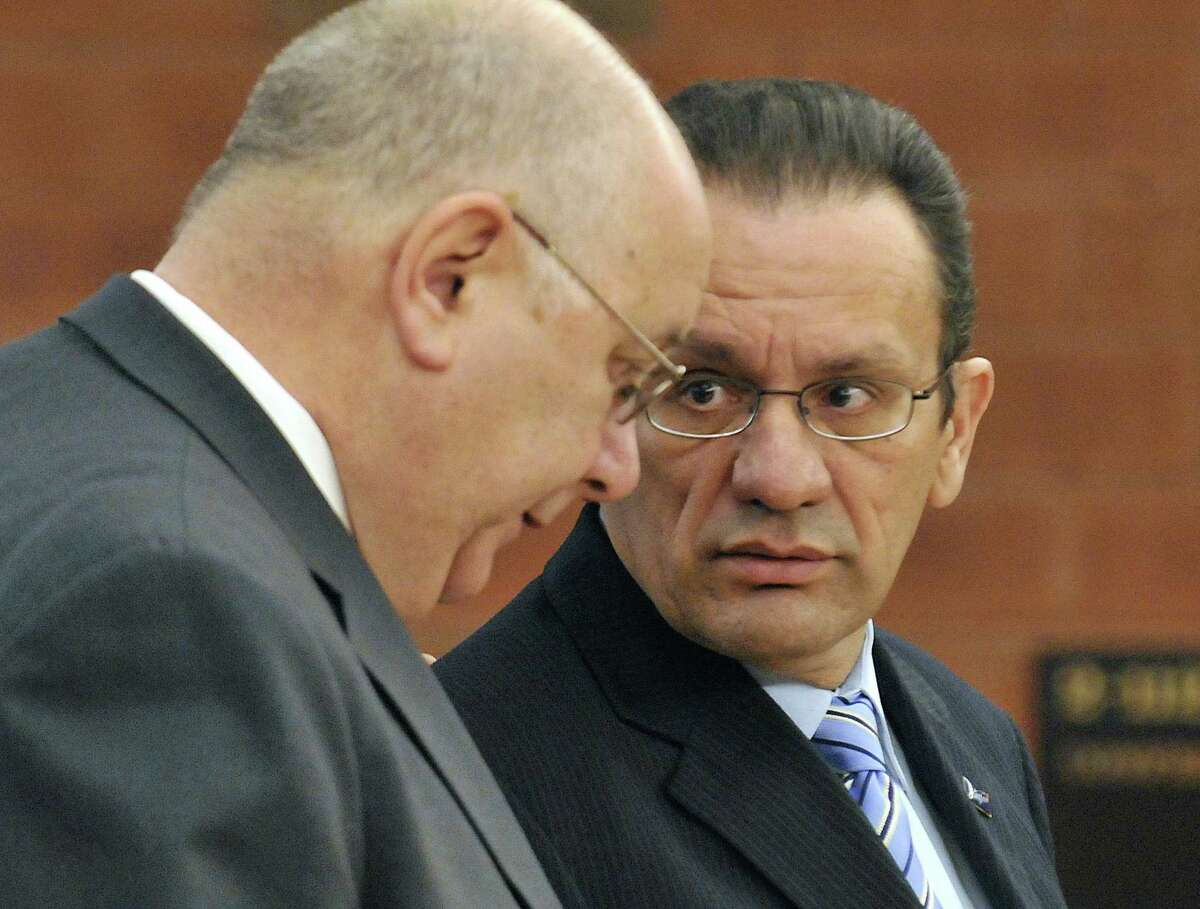 Hartford Mayor Eddie Perez, right, looks to his attorney Hubert Santos during his arraignment in Superior Court in Hartford, Tuesday, Feb. 3, 2009. Perez is charged with receiving a bribe, fabricating physical evidence, and conspiracy to fabricate physical evidence. (AP Photo/Jessica Hill, Pool)