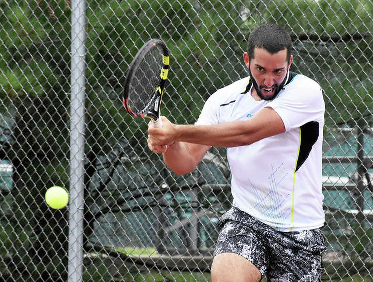 Petros Chrysochos returns a backhand shot that ultimately was the match-clincher to win the 2019 Edwardsville Futures tournament.