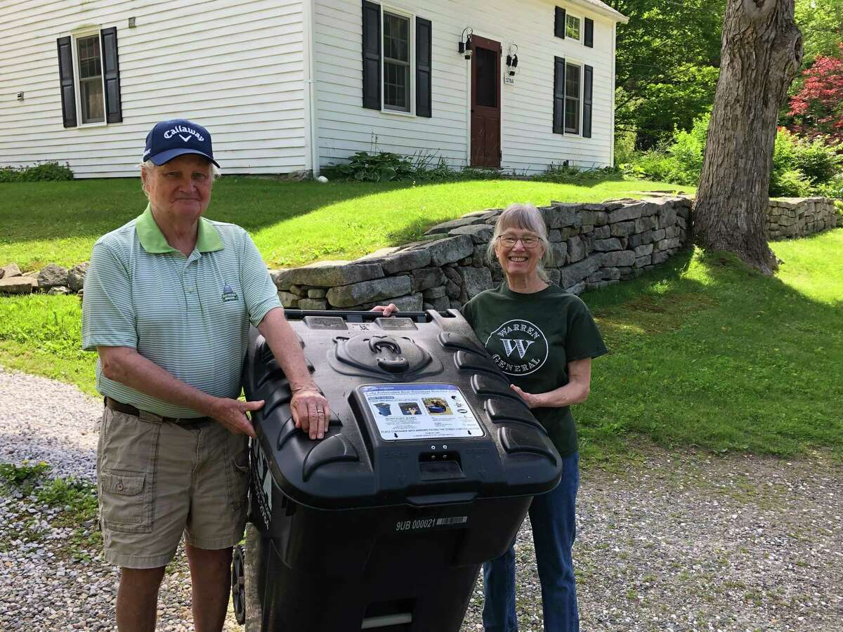 Ted and Nancy Morse with their new bear resistant trash cans