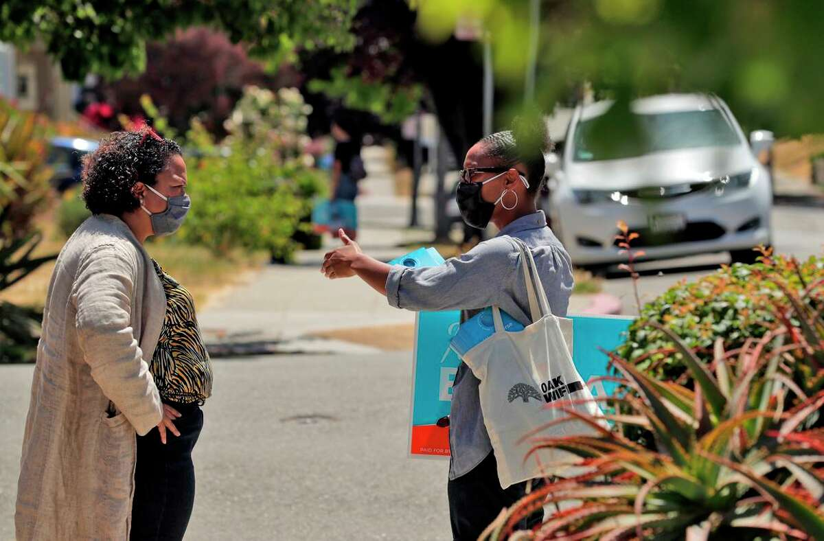 Mia Bonta and campaign manager Rowena Brown stop to talk while campaigning door to door in the Glenview district of Oakland.